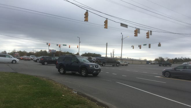 Commuters drive through the Broad Street intersection with Thompson Lane in Murfreesboro. The city's proposed 2040 Major Thoroughfare Plan calls for building a bypass bridge to allow Thompson Lane traffic to pass over Broad or take exit ramps to intersection below.