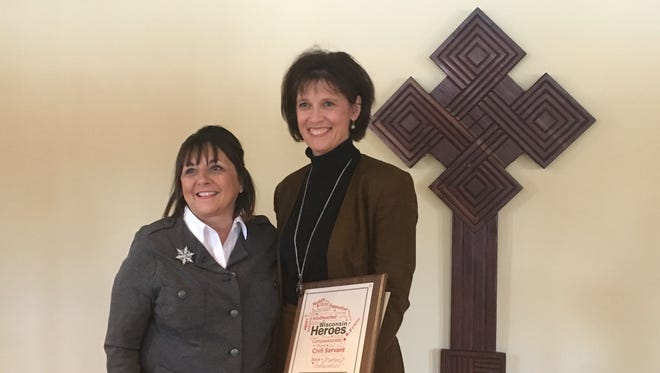 Paula Rieder poses for photos with First Lady of Wisconsin, Tonette Walker, following a surprise award presentation Friday at St. Norbert Abbey in De Pere. Rieder received the Wisconsin Heroes Award for her many charitable causes.