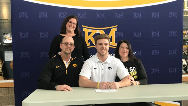 Kettle Moraine senior and Iowa football recruit Mike Timm (center) poses with (from left to right) his father, Steve, stepmother, Jackie, and mother, Amanda.