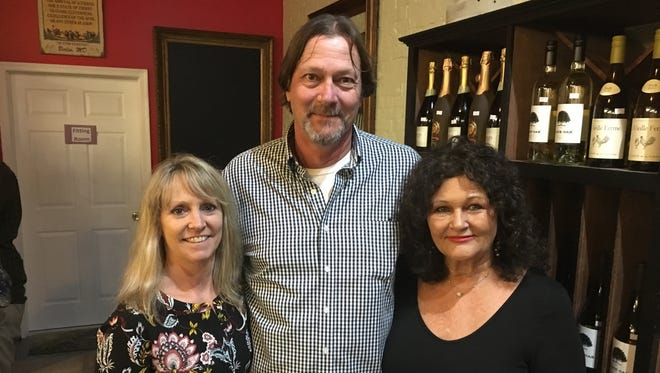 Donna Compher, left, owner of Sisters Mike and Deborah Everett, owners of the Maryland Wine Bar. The two former neighbors will now occupy the same space.