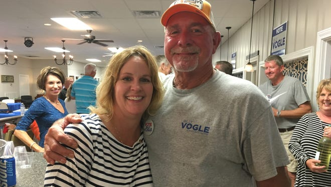 Robertson County Mayor-elect Billy Vogle hugs Court Clerk Lisa Cavender during his victory party Thursday night at the Robertson County Senior Center.