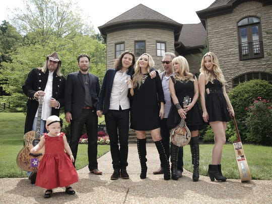The former Mesa residents moved to Nashville 10 years ago and now star in their own reality show based on their country band, Lucy Angel.