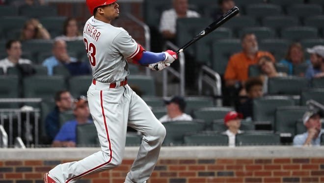 Philadelphia Phillies left fielder Aaron Altherr hits a two-run home run in the eighth inning against the Atlanta Braves at SunTrust Park.