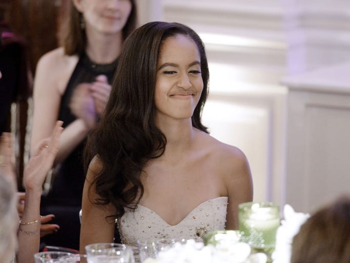 Malia Obama cheeses during a State Dinner at the White