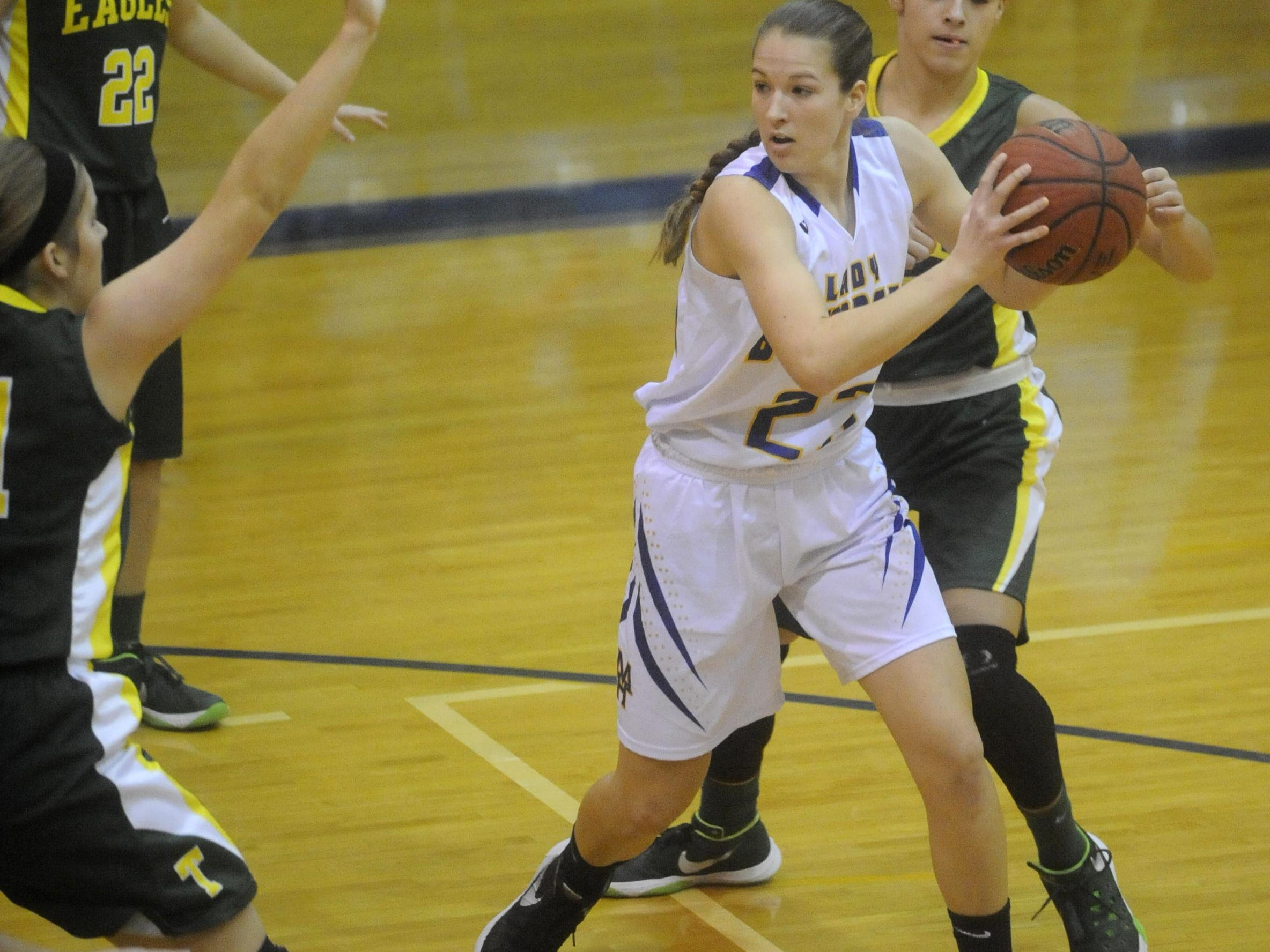 Mountain Home's Maly Tabor is surrounded by a trio of Greene County Tech defenders during a recent game at The Hangar.