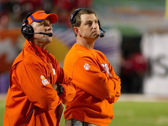Clemson head coach Dabo Swinney (right) and offensive coordinator Chad Morris (left) react during the 2014 Orange Bowl against Ohio State.