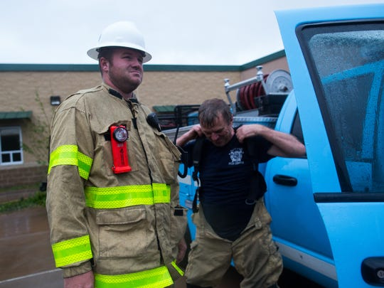 Members of the Fulton Volunteer Fire Department suit up on Saturday, Aug. 26,  after waiting out Hurricane Harvey at the Fulton 4-5 Learning Center.