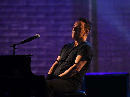 Bruce Springsteen performs a portion of his solo show