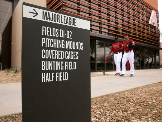 Rubby De La Rosa (49) and Bo Takahashi arrive for the first day of spring training on Feb. 13.