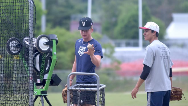 Portsmouth High School baseball players Cal Hewett, left, and Ryan Minckler look on during Tuesday's workout for the New England Independent Baseball League at PHS. Hewett, a senior, is headed to Vanderbilt to play baseball, while Minckler, a junior, is committed to play at Virginia.
