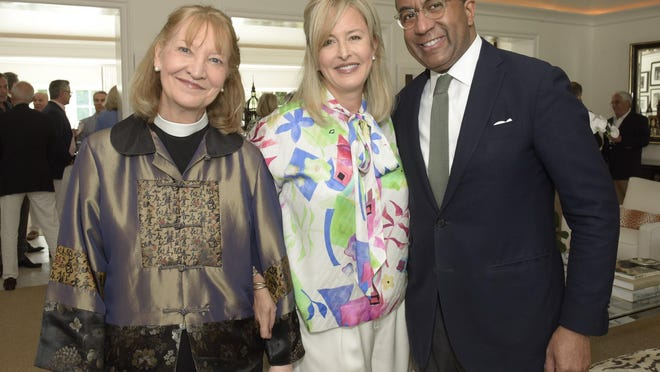 The Rev. Jan Naylor Cope, Jacqui Michel and Eric Motley. Washington National Cathedral reception Feb. 12, 2020, at a private residence.