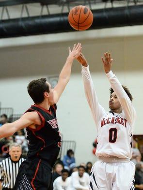 McCaskey's Kobe Gantz takes a shot over Hempfield's