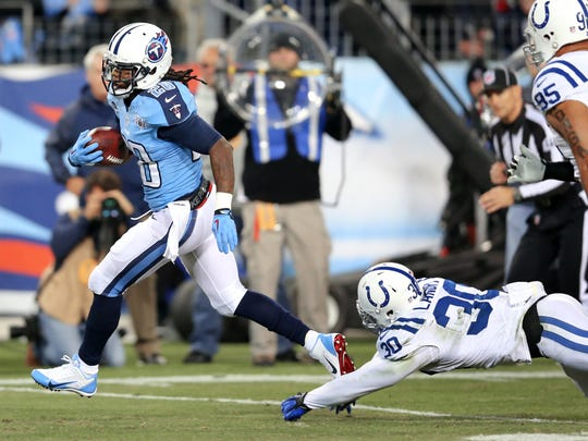 Tennessee running back Chris Johnson blows past Colts safety LaRon Landry for a touchdown in 2013.