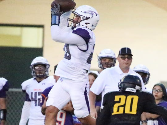 Eastlake's Ivan Avina, 20, rises to catch a pass against
