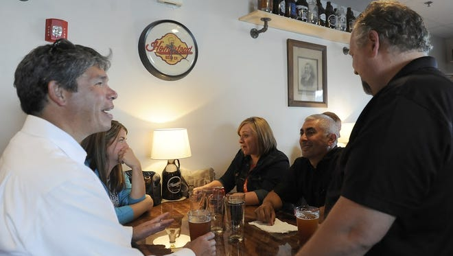 Boeing employees Phil Jordan, Mary Waibel, Kasey Murillo, Eric Murillo, and Hank Fitzgerald chat during the Chamber of Commerce Biz After Hours on Thursday, July 24, 2014 at Homestead Beer Company.