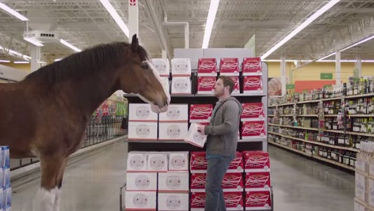 Budwesier will share a couple commercials during Super Bowl XLIX.