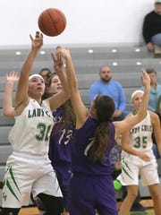 Clear Fork's Macy Wade takes a shot during Tuesday's basketball game with Lexington.