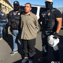 ICE Enforcement and Removal Operations officers escort Mexican fugitive Jose Carlos Campo Gomez on Friday at the Stanton Street Bridge in El Paso.