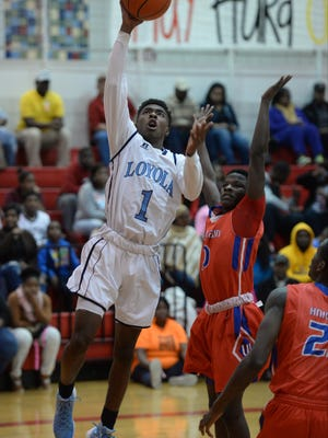 Tony Dorsey of Loyola shoots for two points.
