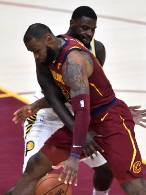 Indiana Pacers guard Lance Stephenson (1) defends Cleveland Cavaliers forward LeBron James (23) in the second quarter at Quicken Loans Arena.