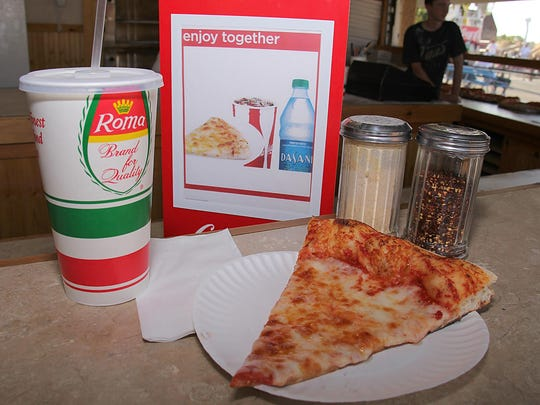 A slice and a soda from Pizza V on the Keansburg boardwalk.
