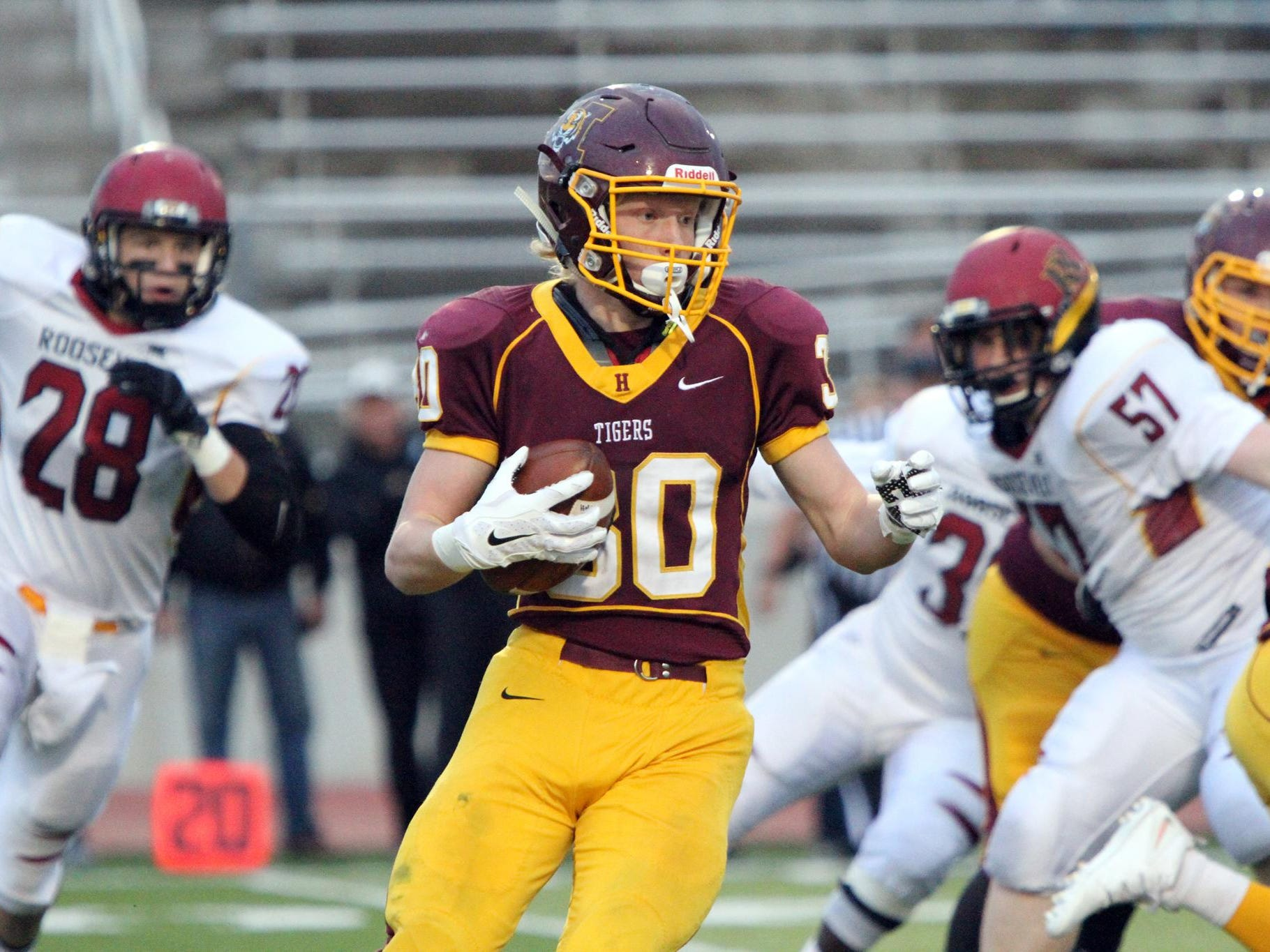 Jack Anderson (30) looks for some running room against Roosevelt.