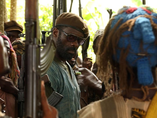 """Idris Elba is often unrecognizable as the Commandant in """"Beasts of No Nation."""""""
