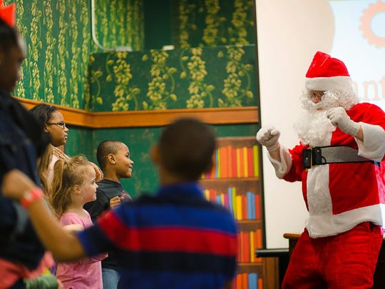 Dance with Santa at Friday's opening of the Mississippi Children's Museum Holiday Spectacular.