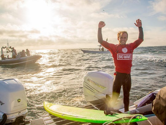 Josh Kerr, formerly of Australia, now of San Diego, California (pictured) celebrating his victory at the Todos Santos Challenge in monstorous 30-40-foot surf at Todos Santos off the coast of Baja, Mexico, on Sunday January 17, 2015.