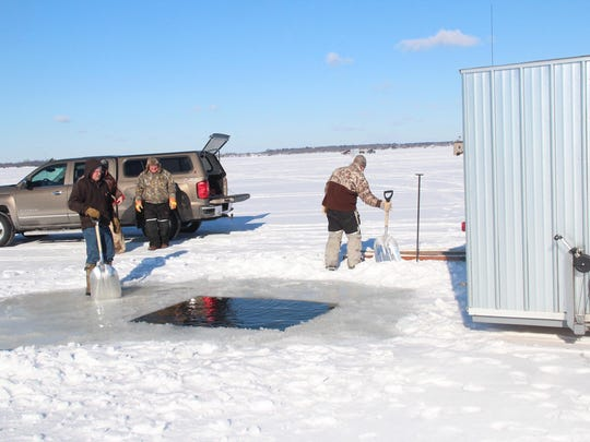 A sturgeon spearing shanty is backed over a hole cut in the ice on Lake Poygan.