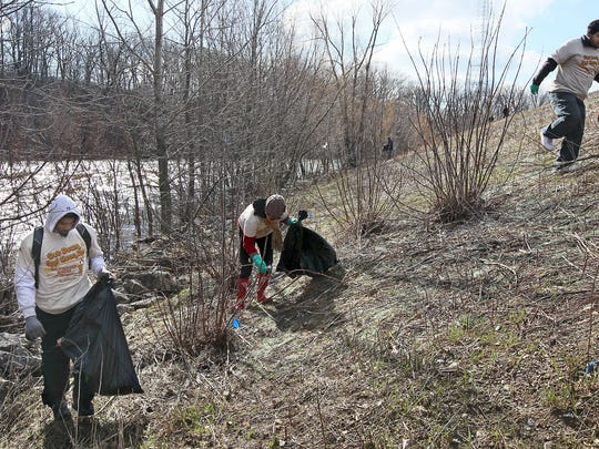Volunteers clean up trash along the Milwaukee River during Milwaukee Riverkeeper's Spring Cleanup in 2013.