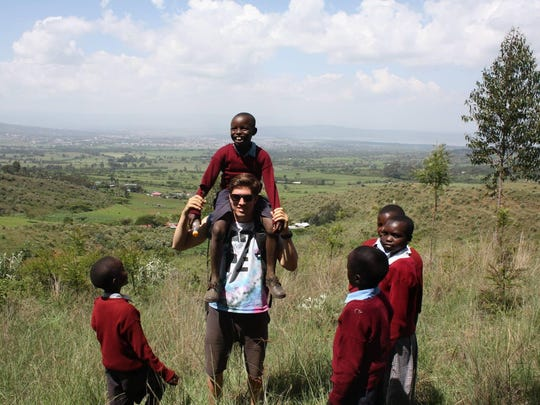 Drew Zaun of Urbandale plays with 6- to 15-year-old students May 25 at Kirobon Primary School in Ngata, Kenya. He is on a three-month trip in Kenya, where he is shadowing and working alongside Hopeful Africa, a nonprofit that was started at Valley High School in 2008.