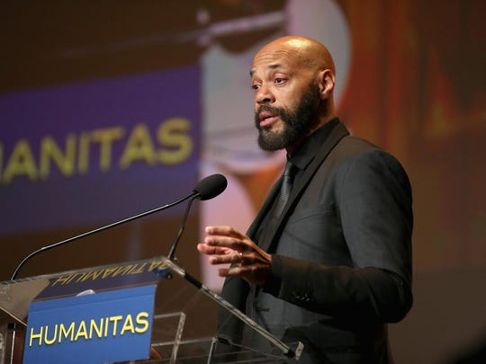 "John Ridley, shown accepting the Kieser Award onstage at the 41st Humanitas Prize Awards Ceremony, was also the driving force behind TV show ""American Crime."""