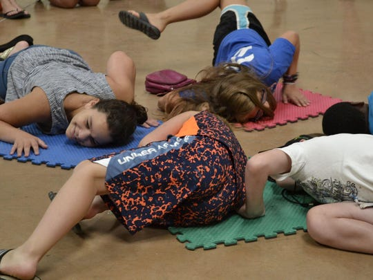 Campers play a version of musical chairs during an activity period Tuesday at First United Methodist Church in Alamo.
