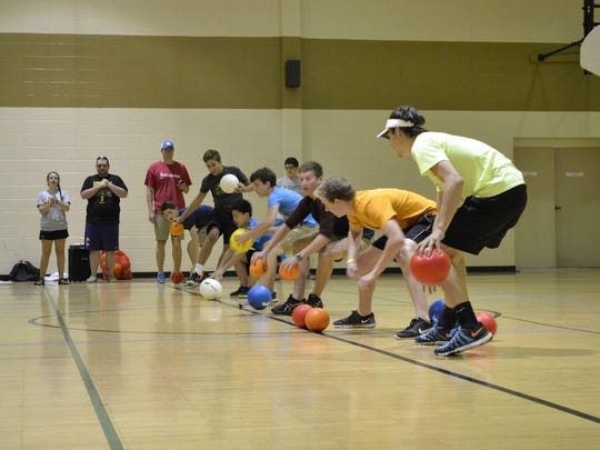 Youth from five local United Methodist churches play dodge ball against each other during Youth Week on Thursday afternoon at Jackson First United Methodist Church.