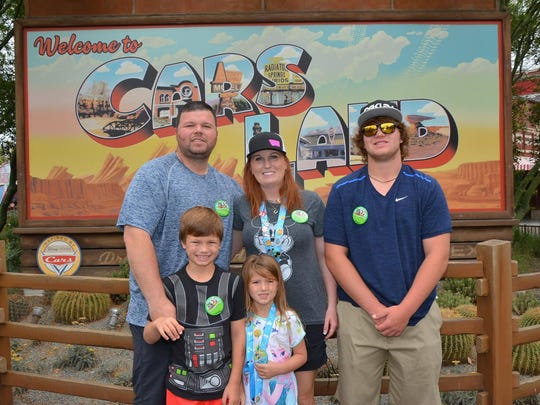 The Hamilton family enjoyed a trip to Disneyland last summer. In the back, from left, Pete, Ryndee and Peter Jr. In front, Jace and Khloe.