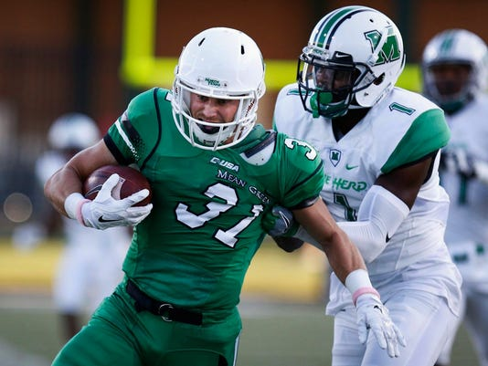 North Texas senior wide receiver Kenny Buyers (31) runs after catching a pass, while Marshall junior safety C.J. Reavis (1) tries to stop him in an NCAA college football game in Denton, Texas Saturday, Oct. 8, 2016. (Jeff Woo/The Denton Record-Chronicle via AP)