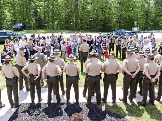 Col. Matthew T. Birmingham, center, director of the Vermont State Police, addresses new troopers and their families following graduation ceremonies for the 105th Basic Training Class and the 40th and 41st Canine Drug Detection Classes at the Vermont Police Academy in Pittsford on Friday, May 25, 2018.
