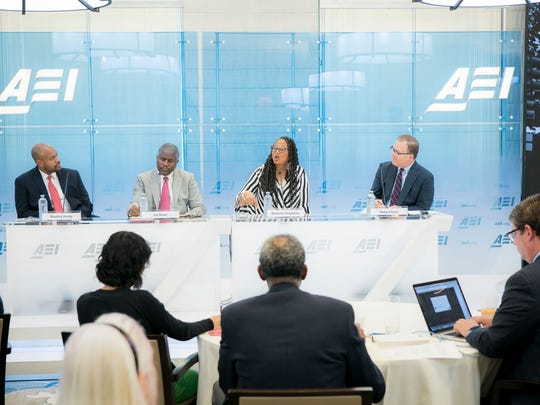 "Panelists respond to the ""Black Men Making It in America"" report  during its June 26, 2018 release at the American Enterprise Institute in Washington, D.C. From left, Bradley Hardy, Ian Rowe, Michelle Singletary and Robert Doar.  The report says the majority of black men make it into at least the middle class by their 50s."