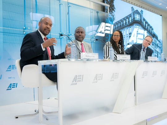"Panelists respond to the ""Black Men Making It in America"" report  during its release June 26, 2018, at the American Enterprise Institute in Washington, D.C. From left, Bradley Hardy, Ian Rowe, Michelle Singletary and Robert Doar.  The report says the majority of black men make it into at least the middle class by their 50s."