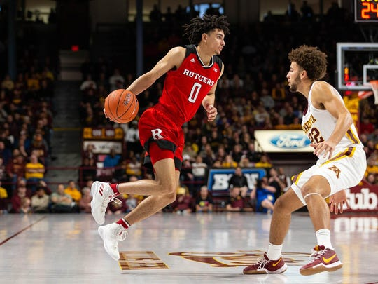 Jan 12, 2019; Minneapolis, MN, USA; Rutgers Scarlet Knights guard Geo Baker (0) dribbles the ball while Minnesota Golden Gophers guard Gabe Kalscheur (22) defends during the second half at Williams Arena. Mandatory Credit: Harrison Barden-USA TODAY Sports