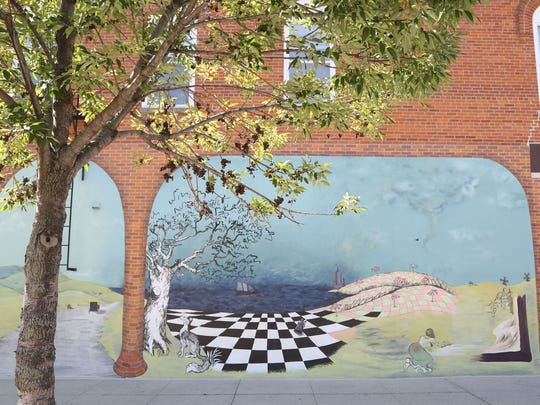 The mural outside of Dulcinea on Monday, July 28, 2014 in downtown Iowa City. This mural is one of several downtown.