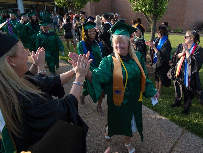 Graduates process for the start of the Delaware Technical