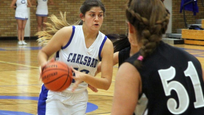 Carlsbad forward Rylan Gonsalez bolts toward the basket against Chaparral Tuesday, Nov. 18, 2014. The Cavegirls host the Lobos tonight.