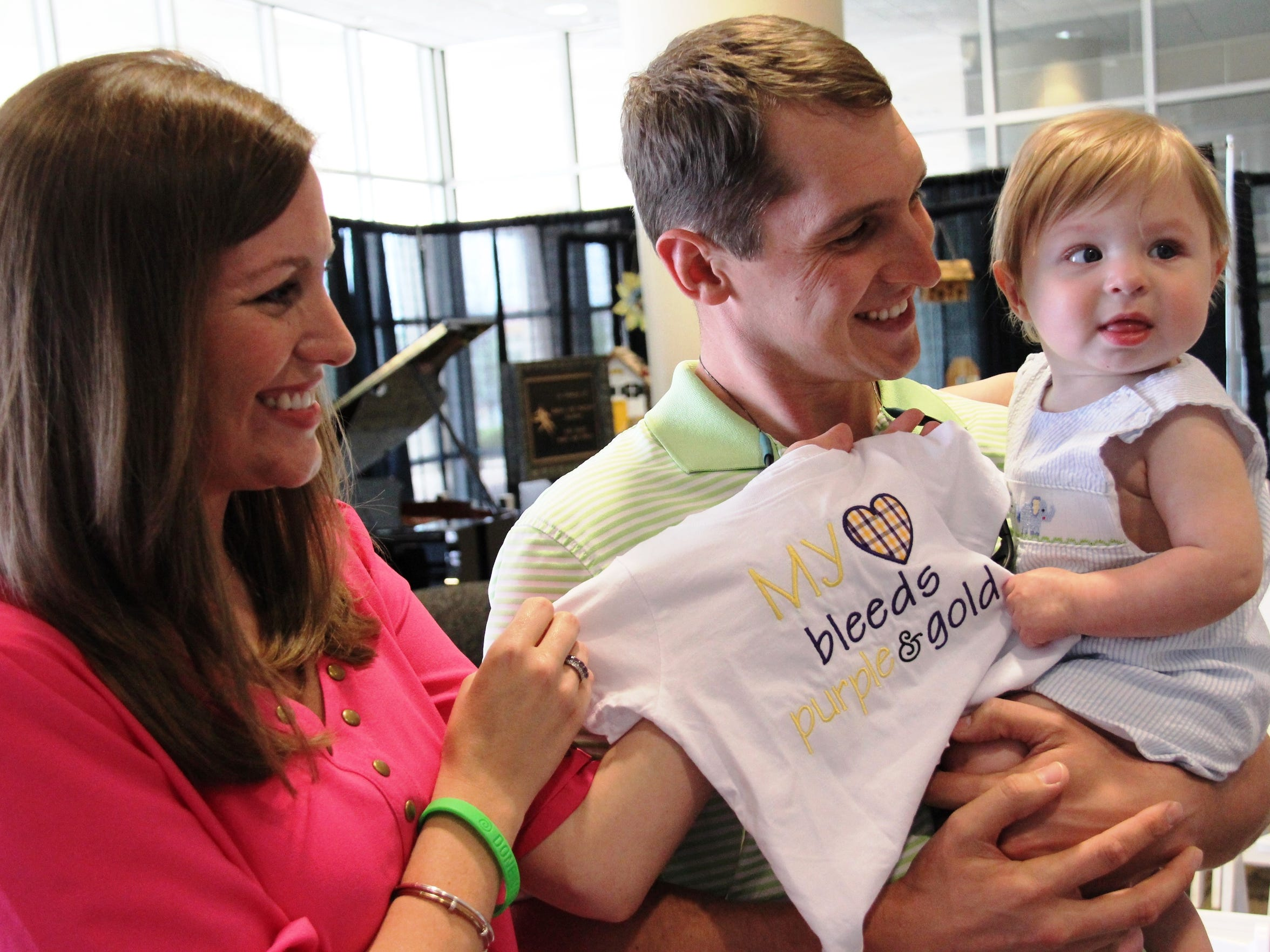 "The Perry family presented Davis Boswell with a shirt that reads ""My heart bleeds purple and gold"" at the Donate Life ceremony. Davis is seen here with his parents, Amanda and Tucker Boswell."