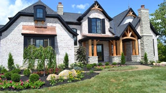 Fulton Manor, built by Gustin Construction Inc. at this year's HomeFest Crown Point, features a French chateau exterior with carriage house doors, solid copper roof finials, black iron windows, mortar covered bricks and rough cedar accents. The house is 5,500 square feet.