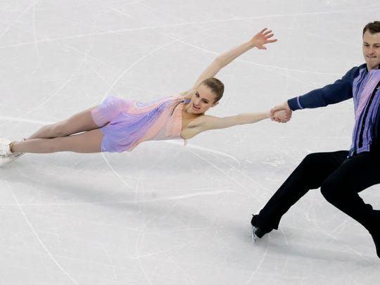 Paige Conners and Evgeni Krasnopolski of Israel perform in the pair figure skating short program in the Gangneung Ice Arena at the 2018 Winter Olympics in Gangneung, South Korea.