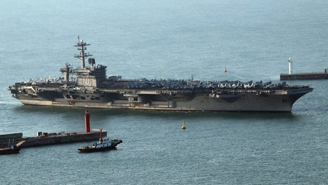 The USS Carl Vinson supercarrier arrives at a port in Busan, South Korea on March 15, 2017