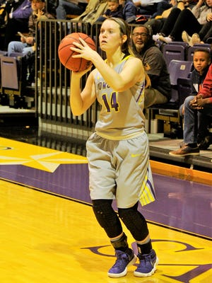 HSU's Danie Mabry lines up a 3-point shot during Saturday's 62-61 loss to Texas Lutheran. Mabry scored a game-high 23 points for the Cowgirls, including five 3s.