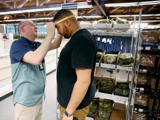 U.S. Navy sailor yeoman Nathan Willis gets measured